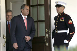 photo -   House Speaker John Boehner of Ohio, center, followed by Senate Minority Leader Mitch McConnell of Ky., leaves the White House the White House in Washington, Friday, Nov. 16, 2012, to speak to the media after meeting with President Barack Obama to discuss the economy and the deficit. (AP Photo/Jacquelyn Martin)  