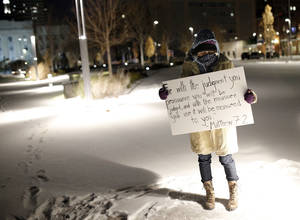 "Photo - Hannah Leggett holds a sign in support of the ÒThe Most Fabulous Story Ever Told"" play at the Civic Center Music Hall in Oklahoma City, Okla.,  Friday, Dec. 6, 2013. Photo by Sarah Phipps, The Oklahoman"