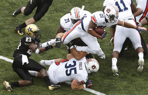 Photo -   Auburn running back Tre Mason (21) is tackled by Vanderbilt cornerback Andre Hal (23) in the second quarter of an NCAA college football game on Saturday, Oct. 20, 2012, in Nashville, Tenn. (AP Photo/Joe Howell)