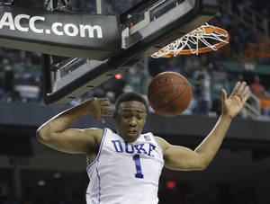 Photo - Duke's Jabari Parker (1) dunks against Clemson during the first half of a quarterfinal NCAA college basketball game at the Atlantic Coast Conference tournament in Greensboro, N.C., Friday, March 14, 2014. (AP Photo/Gerry Broome)