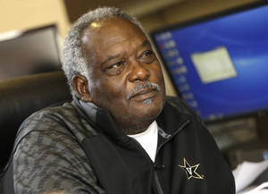 Photo - In this July 16, 2014 photo, Vanderbilt athletic director David Williams is interviewed in his office in Nashville, Tenn. Vanderbilt has set the bar at a new height by winning the school's second national title last month at the College World Series. Now Williams says the challenge is which team is next, and he includes the football team as having a chance too with its recent success. (AP Photo/Mark Humphrey)