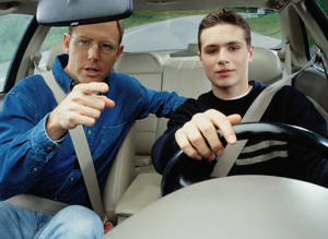 photo - Dave Ramsey recommends that for parents of new drivers, the parents leave the car in a parent's name and pay the extra insurance cost for a little while. <strong>Ryan McVay</strong>