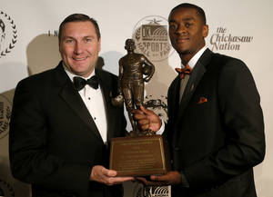 photo - Mississippi State coach Dan Mullen poses with Jim Thorpe Award winner Johnthan Banks of Mississippi State at the Jim Thorpe Museum and Oklahoma Sports Hall of Fame in Oklahoma City, Tuesday, Feb. 5, 2013. Photo by Bryan Terry, The Oklahoman