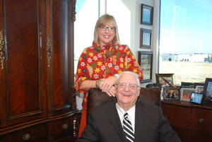 Photo - Debbie Christian, chaplain at Express Employment Professionals, poses for a picture with Bob Funk Sr., the company's chairman, CEO and president.  Photo provided <strong></strong>