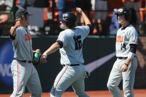 Photo - Oregon State starting pitcher Ben Wetzler, left celebrates runs scored by Beavers' Gabe Clark (16) and Caleb Hamilton (14) againt UNLV during an NCAA college baseball regional tournament game in Corvallis, Ore., Sunday, June 1, 2014. (AP Photo/Mark Ylen)