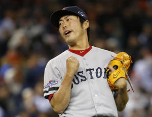 Photo - Boston Red Sox's Koji Uehara reacts after the Red Sox defeating the Detroit Tigers 4-3 in Game 5 of the American League baseball championship series Thursday, Oct. 17, 2013, in Detroit. (AP Photo/Paul Sancya)