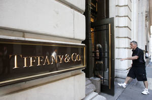 Photo -   FILE - In this Aug. 27, 2010 file photo, a man walks into a Tiffany store on Wall Street in New York. Tiffany & Co. cut its outlook for both sales and profit for the year, citing a slowdown in demand for its jewelry not only in the U.S. but in many other countries. (AP Photo/Mark Lennihan, File)