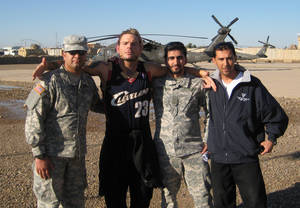 Photo - Professional wrestler Jeff Hardy, second from left, poses with Ahmed Abdullah, left, and two other translators in Balad, Iraq. <strong>PROVIDED - Provided</strong>