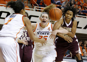photo - OSU: Oklahoma State&#039;s Lindsey Keller (25) and Texas State&#039;s Taylor McGilbra (14) fight for the ball during a women&#039;s college basketball game between Oklahoma State University and Texas State at Gallagher-Iba Arena in Stillwater, Okla., Wednesday, Nov. 28, 2012.  Photo by Bryan Terry, The Oklahoman