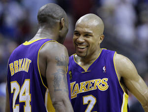 photo - L.A. LAKERS / CHAMPIONSHIP SERIES / CELEBRATION: Los Angeles Lakers' Kobe Bryant (24) and Derek Fisher celebrate after beating the Orlando Magic 99-91 in overtime of Game 4 of the NBA basketball finals Friday, June 12, 2009, in Orlando, Fla. The Lakers take a 3-1 lead in the series. (AP Photo/David J. Phillip) ORG XMIT: DOA181