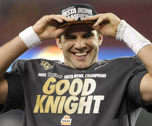 Photo - Central Florida quarterback Blake Bortles puts on his champions hat after the Fiesta Bowl NCAA college football game against Baylor, Wednesday, Jan. 1, 2014, in Glendale, Ariz. Central Florida won 52-42.  (AP Photo/Rick Scuteri)