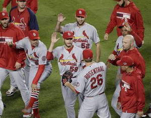 Photo - St. Louis Cardinals relief pitcher Trevor Rosenthal (26) is congratulated by teammates after Game 4 of the National League baseball championship series against the Los Angeles Dodgers Tuesday, Oct. 15, 2013, in Los Angeles. The Cardinals won 4-2 to take a 3-1 lead in the series. (AP Photo/Jae C. Hong)