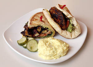 Photo - Seared Caribbean Jerk Chicken sandwich from Saturn Grill. Photo by Paul Hellstern, The Oklahoman