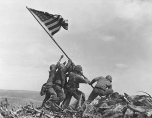Photo - FILE - This Feb. 23, 1945 file photo shows U.S. Marines of the 28th Regiment, 5th Division, raising the American flag atop Mt. Suribachi in Iwo Jima, Japan. Strategically located only 660 miles from Tokyo, the Pacific island became the site of one of the bloodiest, most famous battles of World War II against Japan. The photograph inspired a sculpture by Felix de Weldon which will be auctioned Feb. 22, 2013 in New York. (AP Photo/Joe Rosenthal, File)