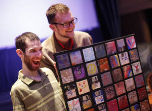 Photo - David Blose, left, and Brandon Smith show a piece of art Wednesday at Will Rogers Theatre in Oklahoma City. Photo by Garett Fisbeck, The Oklahoman