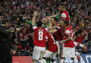 Photo - Arsenal players celebrate their win against Wigan Athletic at the end of their English FA Cup semifinal soccer match at Wembley Stadium in London, Saturday, April 12, 2014. (AP Photo/Sang Tan)