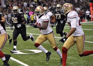 Photo - San Francisco 49ers strong safety Donte Whitner (31) scores on a touchdown run in the second half of an NFL football game against the New Orleans Saints at the Louisiana Superdome in New Orleans, Sunday, Nov. 25, 2012. (AP Photo/Bill Feig)