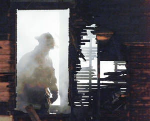 Photo - An Oklahoma City firefighter looks for hot spots in a home at 700 Greenway which was destroyed by fire after the owner tried to thaw frozen pipes with a space heater. <strong>PAUL HELLSTERN</strong>