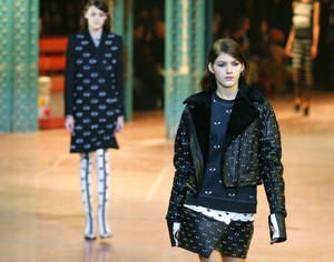 Photo - A model wears a a creation by fashion designers Humberto Leon, from Peru, and Carol Lim, from South Korea for Kenzo Ready to Wear Fall-Winter 2013-2014 fashion collection, presented, Sunday, March 3, 2013 in Paris. (AP Photo/Jacques Brinon)