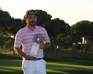 Photo - Victor Dubuisson of France holds his trophy after winning the Turkish Open golf tournament at the Montgomerie Maxx Royal Course in Antalya, Turkey, Sunday, Nov. 10, 2013. (AP Photo/Kaan Soyturk)