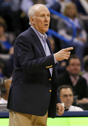 Photo - San Antonio head coach Gregg Popovich gives instructions to his team during an NBA basketball game between the Oklahoma City Thunder and the San Antonio Spurs at Chesapeake Energy Arena in Oklahoma City, Wednesday, Nov. 27, 2013. Photo by Nate Billings, The Oklahoman