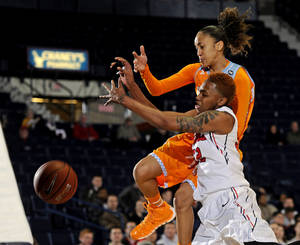 Photo - Tennessee guard Meighan Simmons and Mississippi forward Tia Faleru (32) vie for a rebound during the first half of an NCAA college basketball game in Oxford, Miss., Thursday, Feb. 6, 2014. (AP Photo/Thomas Graning)