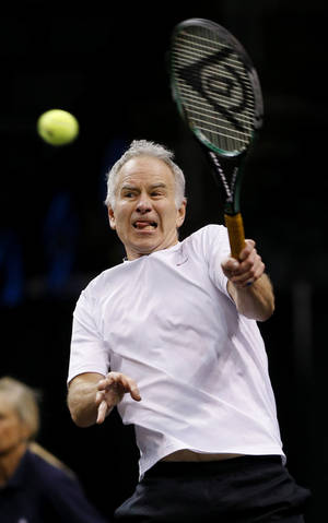 Photo - John McEnroe plays in a Champions Cup tennis match against Ivan Lendl at Chesapeake Energy Arena in Oklahoma City, Thursday, Feb. 6, 2014. Photo by Bryan Terry, The Oklahoman