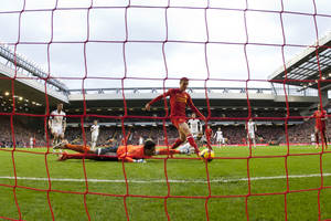 Photo - Liverpool's Jordan Henderson, centre, scores past Swansea City goalkeeper Michel Vorm, bottom left, during their English Premier League soccer match at Anfield Stadium, Liverpool, England, Sunday Feb. 23, 2014. (AP Photo/Jon Super)