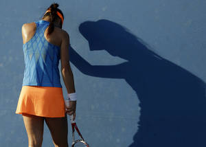 Photo - Sorana Cirstea of Romania rests on the back of the court during her first round match against Marina Erakovic of New Zealand at the Australian Open tennis championship in Melbourne, Australia, Tuesday, Jan. 14, 2014. (AP Photo/Aijaz Rahi)
