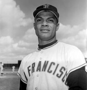 Photo - In this March 8, 1962 file photo Felipe Alou, outfielder for the San Francisco Giants, poses in Casa Grande, Ariz. Alou and Orlando Cepeda were dark-skinned Latinos who knew little English when they arrived in the minor leagues as teenagers, among the first wave of Spanish-speaking players thrown into a new culture to play professional baseball. Both are encouraged to see so many young players from Latin America now arriving in the U.S. with better English skills, thanks in large part to all 30 major league organizations putting more emphasis into such training through academies in the Dominican Republic and Venezuela. (AP Photo/File)