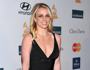 photo -   FILE - In this Feb. 11, 2012 file photo, singer Britney Spears arrives at the Pre-GRAMMY Gala & Salute to Industry Icons with Clive Davis honoring Richard Branson in Beverly Hills, Calif. A judge on Thursday Nov. 1, 2012 dismissed libel, breach of contract and battery claims filed by Spears' former confidante Sam Lutfi against the singer's parents and her conservators. (AP Photo/Vince Bucci, file)