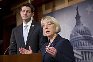 Photo - House Budget Committee Chairman Paul Ryan, R-Wis., left, and Senate Budget Committee Chairwoman Patty Murray, D-Wash., announce a tentative agreement between Republican and Democratic negotiators on a government spending plan, at the Capitol in Washington, Tuesday, Dec. 10, 2013. Negotiators reached the modest budget agreement to restore about $65 billion in automatic spending cuts from programs ranging from parks to the Pentagon, with votes expected in both houses by week's end. (AP Photo/J. Scott Applewhite)