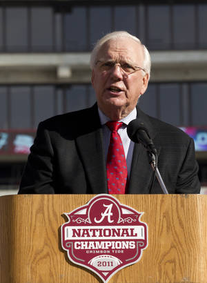 photo - FILE - University of Alabama Athletic Director Mal Moore addresses students and fans at Bryant Denny Stadium in Tuscaloosa, Ala., in this Jan. 21, 2012 file photo. Moore been athletic director since 1999, hiring Saban from the Miami Dolphins in his best career move. The football and athletic administration building is named after him.  (AP Photo/Dave Martin, File)