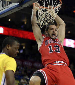 photo - Chicago Bulls' Joakim Noah (13) reacts after scoring over Golden State Warriors' Harrison Barnes during the first half of an NBA basketball game Friday, March 15, 2013, in Oakland, Calif. (AP Photo/Ben Margot)