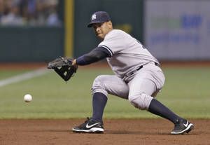 Photo - New York Yankees third baseman Alex Rodriguez cannot field a first-inning double hit by Tampa Bay Rays' Evan Longoria off pitcher CC Sabathia during a baseball game on Saturday, Aug. 24, 2013, in St. Petersburg, Fla. (AP Photo/Chris O'Meara)
