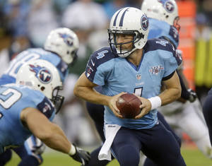 Photo - Tennessee Titans quarterback Ryan Fitzpatrick (4) hands off in the third quarter of an NFL football game against the New York Jets  on Sunday, Sept. 29, 2013, in Nashville, Tenn. Fitzpatrick came in after Jake Locker was injured. The Titans won 38-13. (AP Photo/Wade Payne)