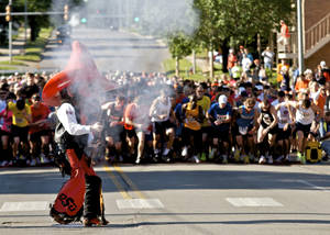 photo - Pistol Pete fires the starting shot to the Remember the Ten run held in Stillwater, Okla., on April 21, 2012. Photos by Mitchell Alcala for The Oklahoman  ORG XMIT: KOD