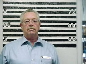Photo - Former  sheriff Mike  Burgess booked at Roger Mills County jail. Provided.  2009 file photo