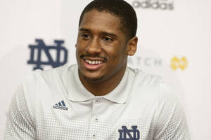 Photo - FILe - In this March 3, 2014 file photo, Notre Dame quarterback Everett Golson speaks to the media after the opening day of spring football practice in South Bend, Ind. Golson admits to being a bit jittery at the first day of spring practice last month after being suspended from school last fall for academic impropriety.  (AP Photo/South Bend Tribune, James Brosher, File)