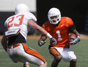 Photo - Joseph Randle (right) looks around Zack Craig during Oklahoma State University's Orange and White game at Boone Pickens Stadium in Stillwater on Saturday, April 16, 2011.  (AP Photo/Tulsa World, Matt Barnard) ORG XMIT: OKTUL203