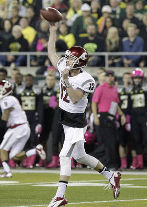 Photo - Washington State quarterback Connor Halliday unleashes a pass during the first half of an NCAA college football game against Oregon in Eugene, Ore., Saturday, Oct. 19, 2013. (AP Photo/Don Ryan)