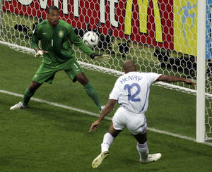 Photo - FILE - In this July 1, 2006 file photo, France's Thierry Henry, right, scores past Brazil goalkeeper Dida, during their World Cup quarterfinal soccer match, in Frankfurt, Germany. On this day: France beats Brazil 1-0 to claim a surprise semifinal berth. (AP Photo/ Lionel Cironneau, File)