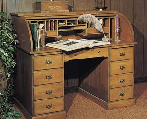 Photo - The pedestal base holds seven big drawers and two pullout drawing boards. On top, 16 pigeonholes are perfect for sorting and filing, and two small drawers hold postage, pens and other supplies. Best of all, at the end of the day simply pull down the tambour cover to conceal and secure work-in-progress. Photo provided