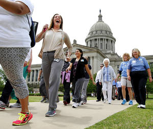 Photo - About 225 state workers, including cabinet members and  agency heads joined Gov. Mary Fallin  on the second wellness walk during the noon hour on  Wednesday, May, 15, 2013. The goal of the event is to promote fitness and exercise among state's residents. The group walked around the north side of the Capitol office complex.  Photo  by Jim Beckel, The Oklahoman.