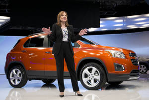 Photo - Mary Barra, CEO of General Motors, talks in front of the Chevrolet Trax at the New York International Auto Show, Tuesday, April 15, 2014 in New York. The Chevrolet Trax will go on sale in the U.S. and China early next year. (AP Photo/Mark Lennihan)