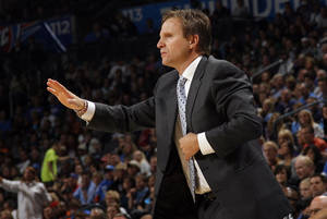 photo - Oklahoma City head coach Scott Brooks calls a play during the NBA game between the Oklahoma City Thunder and the Boston Celtics, Sunday, Nov. 7, 2010, at the Oklahoma City Arena. Photo by Sarah Phipps, The Oklahoman