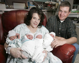 photo - Jennifer and Rick Payne hold their newborn quadruplets  at Mercy Health Center in Oklahoma City on Dec. 17, 2007. Photo BY STEVE GOOCH, THE OKLAHOMAN Archives