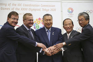 Photo - From left, IOC Executive Director for the Olympic Games Gilbert Felli, IOC Vice President John Coates, Tokyo Organizing Committee of the Olympic and Paralympic Games President Yoshiro Mori, Chief Executive Officer Toshiro Muto, and Tsunekazu Takeda, a member of the International Olympic Committee and president of Japanese Olympic Committee, join hands to pose for photographers during a press conference after the first coordination commission meeting for the Tokyo 2020 Games, in Tokyo Friday, June 27, 2014. The IOC wrapped up its first coordination commission meeting on Friday, saying any changes to the venue plan should not alter the core principles of the city's winning bid. Japanese Olympic organizers are reviewing their venue plans because of concerns over costs and have suggested some venues may have to be moved. (AP Photo/Koji Sasahara)