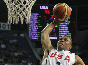 Photo - SA's Russell Westbrook slam dunks the ball during the quarterfinal round match against Russia at the World Basketball Championship, Thursday, Sept. 9, 2010, in Istanbul, Turkey.  (AP Photo/Thanassis Stavrakis)