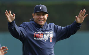 Photo - Detroit Tigers' Miguel Cabrera stretches during baseball practice in Detroit, Tuesday, Oct. 1, 2013. Detroit plays the Oakland Athletics in the AL division series starting Friday. (AP Photo/Paul Sancya)